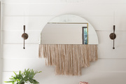 Fringed mirror in entryway.