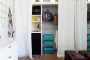 A front closet filled with kitchen and storage supplies