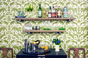Green and white wallpaper compliments a kitchen bar