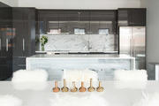 Black and white kitchen with high gloss cabinets and large island.