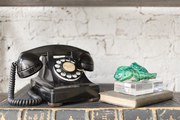 A vintage telephone and objets at Buckingham Interiors + Design