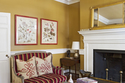 A striped settee in a living space