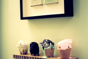 Framed vintage cigarette packaging above an art installation of faux ice cream cones