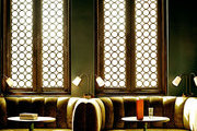 Arched windows and velvet banquettes at Palihouse Santa Monica