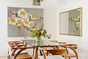 A mid-century modern dining room with a brutalist chandelier.