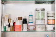 Beauty items that take up most bathroom storage cabinets.
