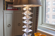 A crystal desk lamp in the corner of a living room