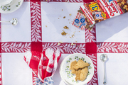 Crackerjack and cookies on an outdoor picnic table