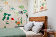 A guest room with fruit and greenery featured in the art.