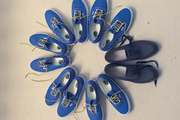 A circle of blue shoes