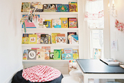 Book storage and a beanbag chair in a kids' playroom