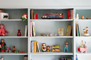 Built-in bookshelves hold toys and books