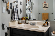 Powder room with custom accent wall and vintage graphics.