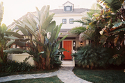 Stone pathways leading to a home with a red front door in the Pacific Palisades
