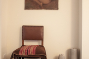 Artwork hung above a leather chair