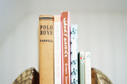 Clamshell bookends on a white shelf