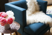 A shearling throw over a modern armchair