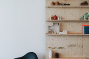 A wooden shelf in a Bohemian workspace.