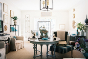 Multiple seating arrangements anchored by a circular table and a black lantern