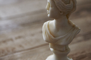 A vintage bust on a weathered wood table