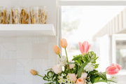 A detail of florals and shelving in a contemporary kitchen.