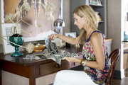 Designer Tami Ramsay at the wood desk in her home office