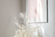 Subtle artwork and floral detail in sunny art deco apartment