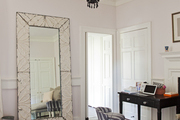 A beaded black chandelier and a hide rug in a dressing space