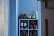 A bright blue mudroom with built in shoe storage,  designed by BHDM Design.