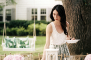 Lauren McGrath setting the table for an outdoor party