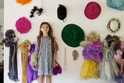 A kids' room wall covered with hats