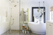 A large soaking tub and a glass shower together in a sophisticated master bathroom