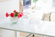 Small flowers atop white table.