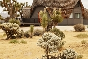A dome house in a desert setting.