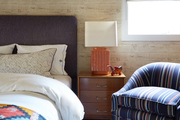 Blue, beige and brown contemporary bedroom with an orange lamp.