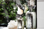 A detail of crystals and silver vessels.