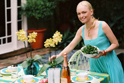 Lulu Powers setting the table for a summer outdoor dinner party