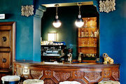 A carved wood bar at Palihouse Santa Monica