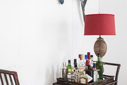 A sailfish above a rattan bar cart