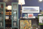 Mirrors, lamps, and artwork on display in a retail environment