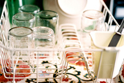 A drying rack filled with dishes atop a floral tray