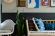 Detail of custom grass cloth bench seat and eclectic gallery wall with juju hat.
