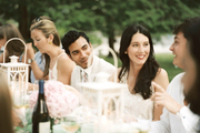 Lauren McGrath surrounded by friends at an outdoor dinner party