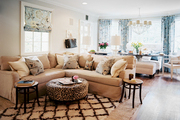 A tan sectional in an open family room