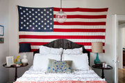 The American flag as art piece in a master bedroom suite