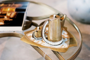 A glass-and-brass coffee table