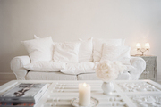 A white couch and a white coffee table in a neutral living space