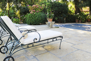 Pool chaises on a stone patio
