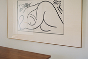 Contemporary wall art and line drawing in kitchen entryway