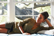 Actress Joy Bryant on a window seat in her home